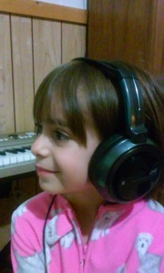 My daughter listening to my new piano song due to be released next month.